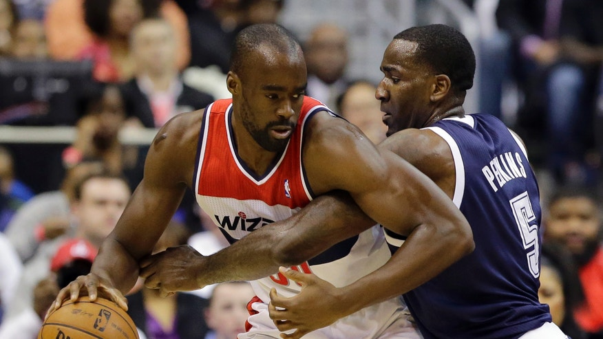 Washington Wizards center Emeka Okafor works against Oklahoma City Thunder center Kendrick Perkins in the first half of an NBA basketball game Monday, Jan. 7, 2013, in Washington. (AP Photo/Alex Brandon)