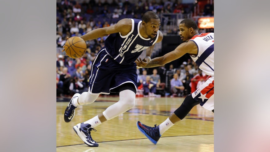 Oklahoma City Thunder forward Kevin Durant gets past Washington Wizards forward Trevor Ariza in the first half of an NBA basketball game Monday, Jan. 7, 2013, in Washington. (AP Photo/Alex Brandon)