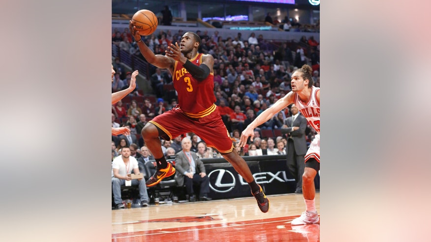 Cleveland Cavaliers guard Dion Waiters (3) scores past Chicago Bulls center Joakim Noah during the first half of an NBA basketball game Monday, Jan. 7, 2013, in Chicago. (AP Photo/Charles Rex Arbogast)