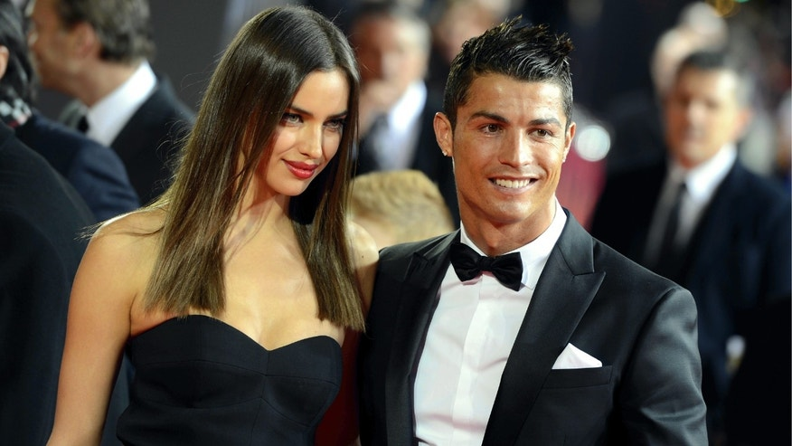 Portugals Cristiano Ronaldo, right, arrives with his girlfriend Irina Shayk, left, on the red carpet prior to the FIFA Ballon d'Or Gala 2013 held at the Kongresshaus in Zurich, Switzerland, on Monday, Jan. 7, 2013. (AP Photo/Keystone/Walter Bieri)