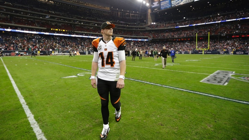 Cincinnati Bengals quarterback Andy Dalton  walks off the field after losing 19-13 against the Houston Texans at an NFL wild card playoff football game Saturday, Jan. 5, 2013, in Houston. (AP Photo/Eric Gay)