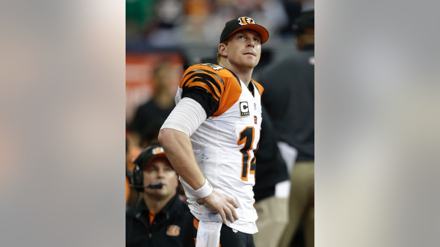 Cincinnati Bengals quarterback Andy Dalton watches action against the Houston Texans on a video scoreboard during the fourth quarter of an NFL wild card playoff football game Saturday, Jan. 5, 2013, in Houston. (AP Photo/Eric Gay)