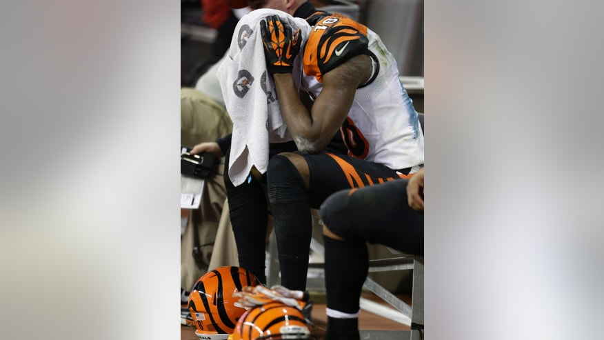 Cincinnati Bengals wide receiver A.J. Green sits on the bench in the final moments against the Houston Texans at an NFL wild card playoff football game Saturday, Jan. 5, 2013, in Houston. Houston won 19-13. (AP Photo/Eric Gay)