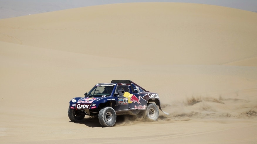 Driver Nasser Al-Attiyah of Qatar and co-driver Lucas Cruz of Spain compete in the 3nd stage of the 2013 Dakar Rally from Pisco to Nazca, Peru, Monday, Jan. 7, 2013. The race finishes in Santiago, Chile, on Jan. 20. (AP Photo/Victor R. Caivano)