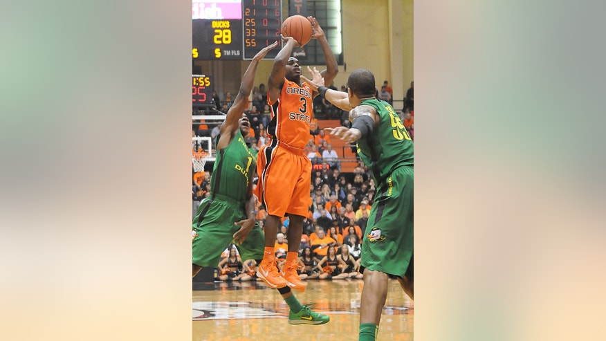 Oregon State's Ahmad Starks shoots a three-pointer during the Civil War game Sunday Jan. 6, 2013 at Gill Coliseum in Corvallis, Ore. (AP Photo/Jesse Skoubo, Corvallis Gazette-Times)