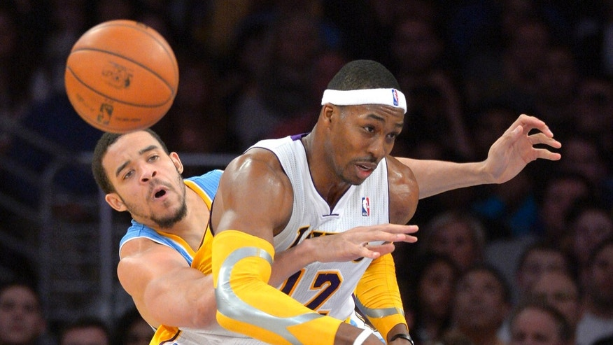 Denver Nuggets center JaVale McGee, left, knocks the ball from the hands of Los Angeles Lakers center Dwight Howard during the second half of their NBA basketball game, Sunday, Jan. 6, 2013, in Los Angeles. The Nuggets won 112-105. (AP Photo/Mark J. Terrill)