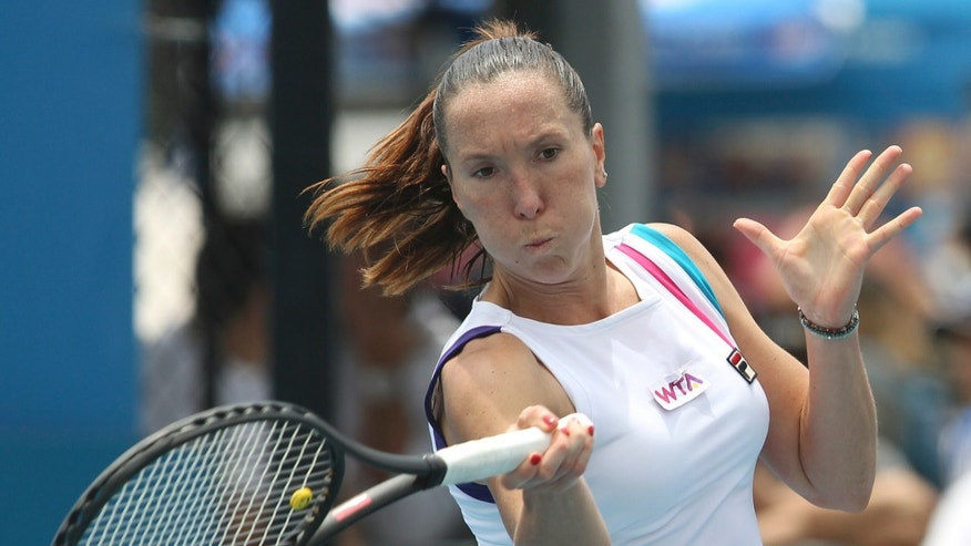 Serbia's Jelena Jankovic plays a forehand shot in her match against Austria's Tamira Paszek at the Sydney International Tennis tournament in Sydney, Australia, Monday, Jan. 7, 2013.  (AP Photo/Rob Griffith)