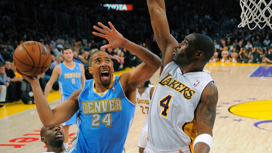 Denver Nuggets guard Andre Miller, center, goes up for a shot as Los Angeles Lakers forward Antawn Jamison, right, defends and guard Jodie Meeks looks on during the first half of their NBA basketball game, Sunday, Jan. 6, 2013, in Los Angeles. (AP Photo/Mark J. Terrill)