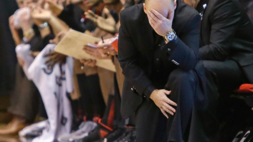 Cincinnati coach Mick Cronin hangs his head in the second half of an NCAA college basketball game against Notre Dame, Monday, Jan. 7, 2013, in Cincinnati. Notre Dame won 66-60. (AP Photo/Al Behrman)