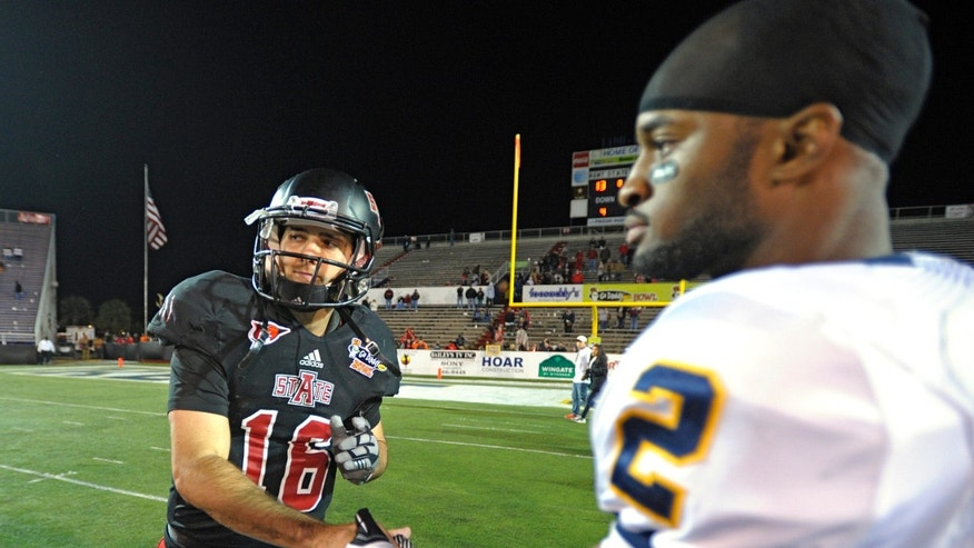 Arkansas State quarterback Ryan Aplin (16) is congratulated by Kent State safety Sal Battles (2, right) at the end of the 2013 GoDaddy.com Bowl NCAA college football game in Mobile, Ala., Sunday, Jan. 6, 2013.  Arkansas State won 17-13. (AP Photo/G.M. Andrews)