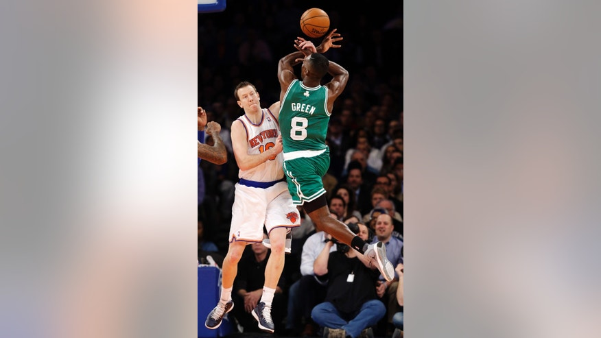 New York Knicks forward Steve Novak (16) blocks a shot by Boston Celtics forward Jeff Green (8) in the first half of their NBA basketball game at Madison Square Garden in New York, Monday, Jan. 7, 2013. (AP Photo/Kathy Willens)