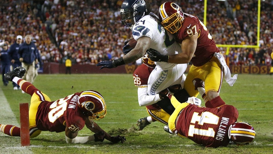 Seattle Seahawks running back Marshawn Lynch gets past several Washington Redskins defenders on his way to a touchdown in the second half of an NFL football wild card playoff game Sunday, Jan. 6, 2013, in Landover, Md. (AP Photo/The Seattle Times, John Lok) SEATTLE OUT  MAGS OUT  NO SALES  MANDATORY CREDIT  TV OUT  USA TODAY OUT