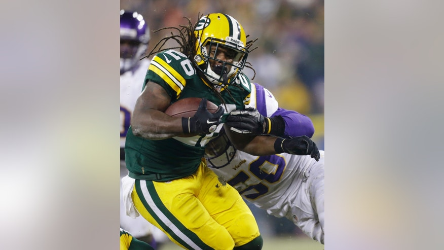 Green Bay Packers running back DuJuan Harris (26) gets tackled by Minnesota Vikings outside linebacker Erin Henderson (50) during the second half of an NFL wild card playoff football game Saturday, Jan. 5, 2013, in Green Bay, Wis. (AP Photo/Jeffrey Phelps)