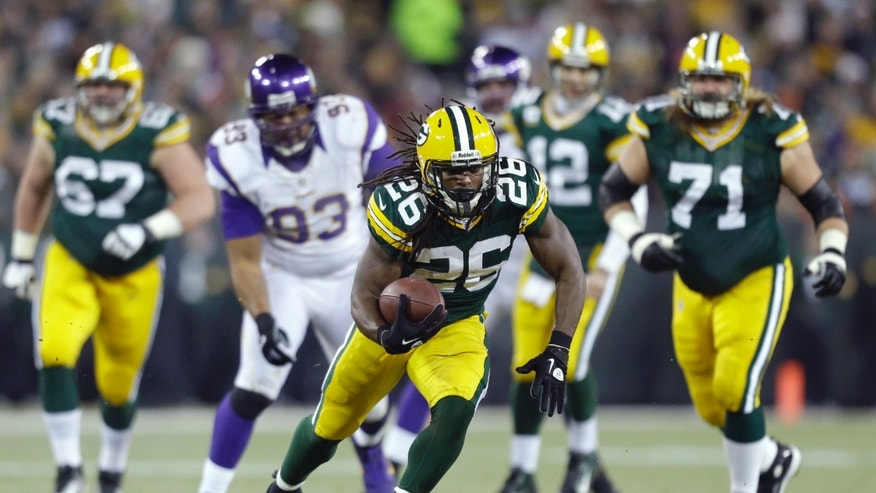 Green Bay Packers running back DuJuan Harris (26) runs during the first half of an NFL wild card playoff football game against the Minnesota Vikings Saturday, Jan. 5, 2013, in Green Bay, Wis. (AP Photo/Jeffrey Phelps)