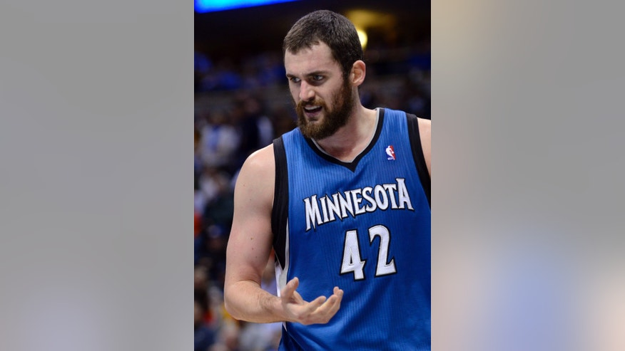 Minnesota Timberwolves forward Kevin Love (42) reacts to his injured right hand during the third quarter of an NBA basketball game against the Denver Nuggets, Thursday, Jan. 3, 2013, in Denver. (AP Photo/Jack Dempsey)