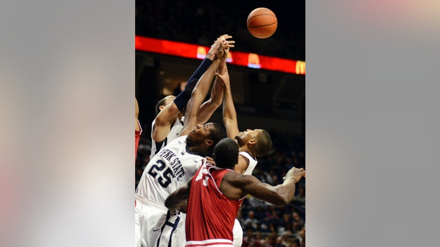 Penn State's Jon Graham (25) struggles for possession of a rebound during the first half of an NCAA college basketball game against Indiana in State College, Pa., Monday, Jan. 7, 2013. (AP Photo/Ralph Wilson)