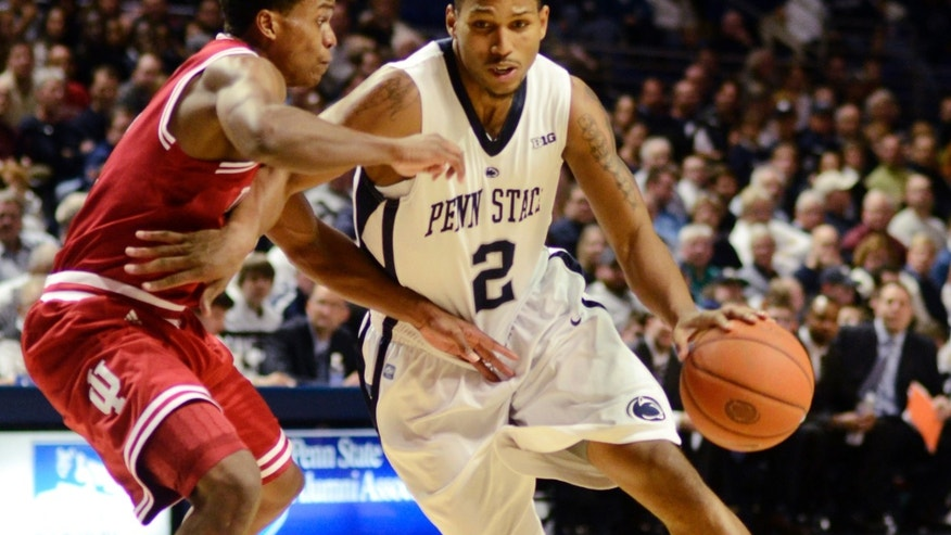 Penn State's D.J Newbill (2) drives against Indiana's Kevin Ferrell during the first half of an NCAA college basketball game in State College, Pa., Monday, Jan. 7, 2013. (AP Photo/Ralph Wilson)