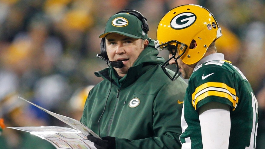 Green Bay Packers head coach Mike McCarthy, left, talks to quarterback Aaron Rodgers during the second half of an NFL wild card playoff football game against the Minnesota Vikings Saturday, Jan. 5, 2013, in Green Bay, Wis. Packers won 24-10. (AP Photo/Mike Roemer)