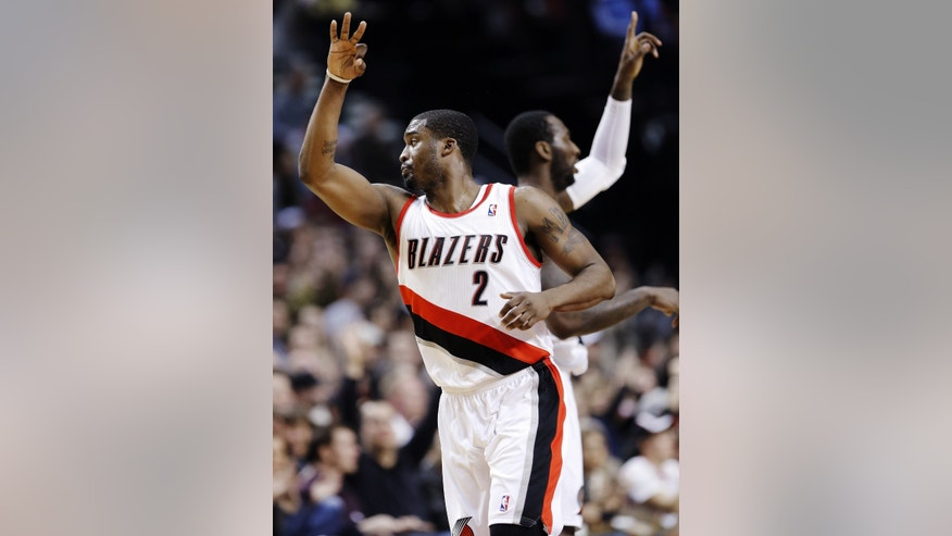 Portland Trail Blazers guard Wesley Matthews, left, celebrates with J.J. Hickson after hitting a 3-pointer during the first quarter of an NBA basketball game against the Orlando Magic in Portland, Ore., Monday, Jan. 7, 2013. (AP Photo/Don Ryan)