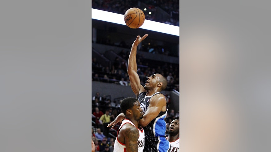 Orlando Magic guard Arron Afflalo, right, shoots over Portland Trail Blazers' Wesley Matthews during the first quarter of an NBA basketball game in Portland, Ore., Monday, Jan. 7, 2013. (AP Photo/Don Ryan)
