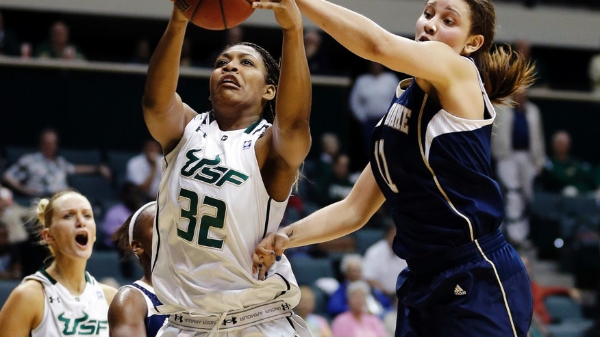 South Florida center Akila McDonald (32) and Notre Dame forward Natalie Achonwa (11) battle for a rebound during the second half of an NCAA college basketball game, Tuesday, Jan. 8, 2013, in Tampa, Fla. Notre Dame won 75-71 in overtime. (AP Photo/Chris O'Meara)