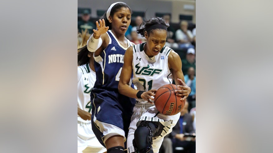 South Florida guard Andrea Smith (21) attempts to control the ball in front of Notre Dame guard Skylar Diggins (4) during the first half of an NCAA college basketball game, Tuesday, Jan. 8, 2013, in Tampa, Fla. Smith scored 33 points in South Florida's 75-71 overtime loss to Notre Dame. (AP Photo/Chris O'Meara)