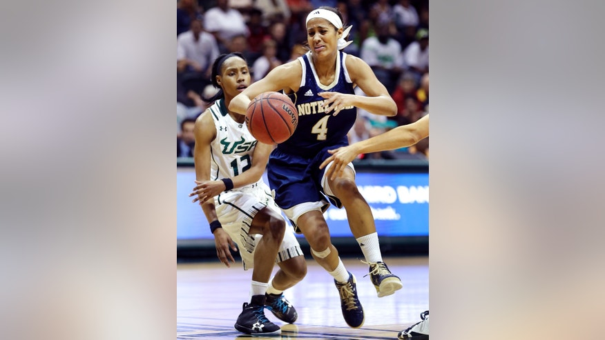 Notre Dame guard Skylar Diggins (4) grimaces after getting the ball stripped away by South Florida guard Andrell Smith (12) during the first half of an NCAA college basketball game, Tuesday, Jan. 8, 2013, in Tampa, Fla. (AP Photo/Chris O'Meara)