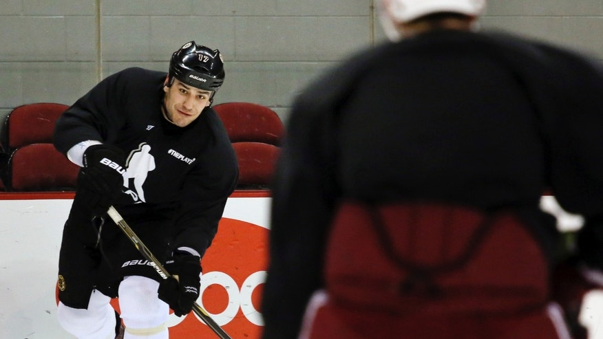 Boston Bruins' Milan Lucic skates during an informal hockey practice session a day after the end of the NHL labor lockout, Monday, Jan. 7, 2013, at Boston University in Boston. (AP Photo/The Boston Herald, Mark Garfinkel)  BOSTON GLOBE OUT; METRO BOSTON OUT; MAGS OUT; ONLINE OUT