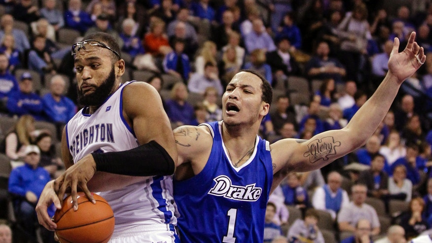 Creighton's Gregory Echenique, left, competes for the ball against Drake's Jordan Clarke in the second half of an NCAA college basketball game in Omaha, Neb., Tuesday, Jan. 8, 2013. Creighton won 91-61. (AP Photo/Nati Harnik)