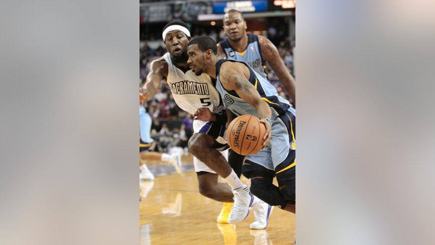 Memphis Grizzlies guard Mike Conley, right, drives against Sacramento Kings forward John Salmons during the first quarter of an NBA basketball game in Sacramento, Calif., Monday, Jan. 7, 2013.(AP Photo/Rich Pedroncelli)