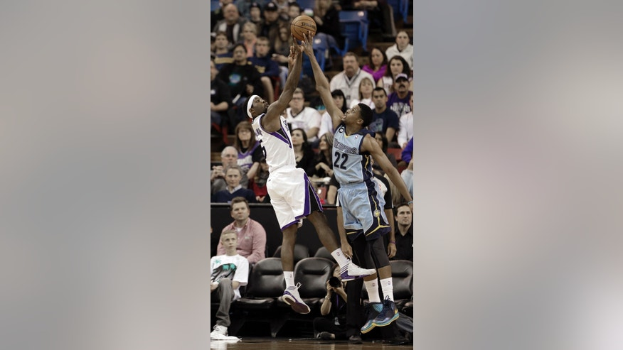 Memphis Grizzlies forward Rudy Gay,right, blocks the shot of  Sacramento Kings  forward John Salmons during the first quarter of an NBA basketball game in Sacramento, Calif., Monday, Jan. 7, 2013.(AP Photo/Rich Pedroncelli)