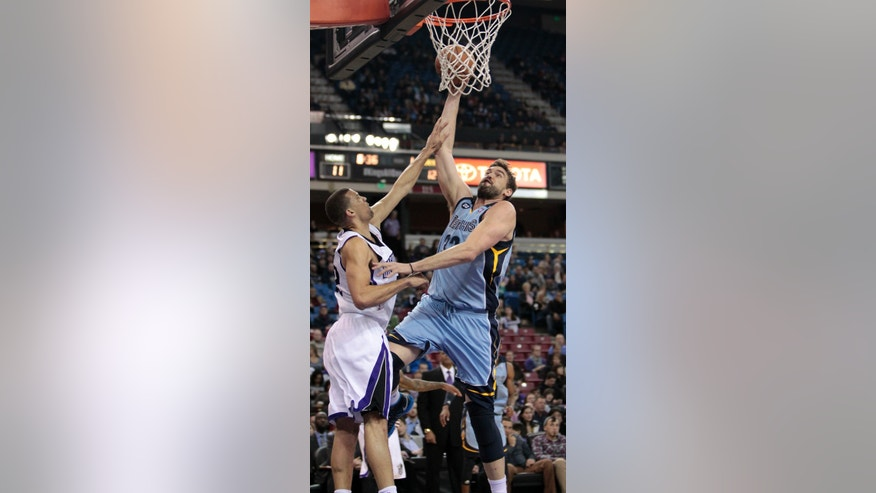 Memphis Grizzlies center Marc Gasol, of Spain, right, is fouled by Sacramento Kings forward Francisco Garcia during the first quarter of an NBA basketball game in Sacramento, Calif., Monday, Jan. 7, 2013.(AP Photo/Rich Pedroncelli)