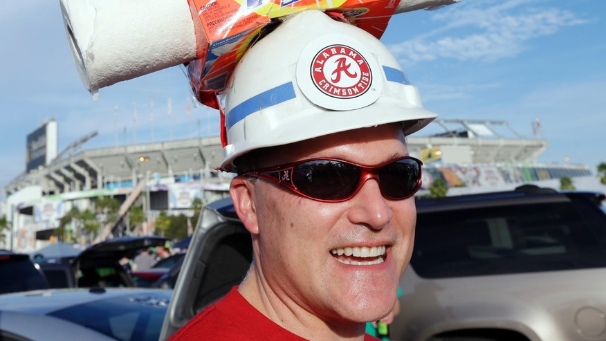 Brian Dawes of Decatur, Ala., makes his way to Sun Life Stadium before the BCS National Championship college football game between the Alabama and the Notre Dame Monday, Jan. 7, 2013, in Miami. (AP Photo/Chris O'Meara)