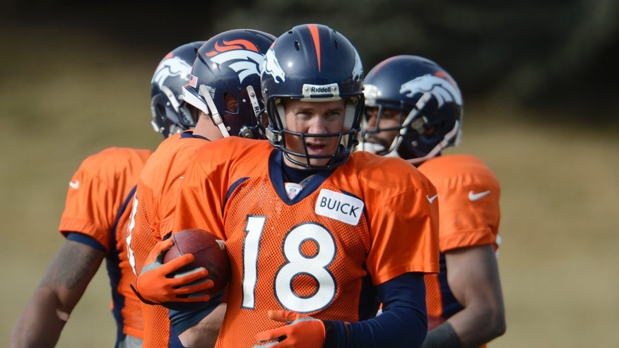 Denver Broncos quarterback Peyton Manning (18) runs through drills during the NFL football team's practice Tuesday, Jan. 8, 2013, in Englewood, Colo. The Broncos play the Baltimore Ravens at home on Saturday in a playoff game. (AP Photo/The Denver Post, John Leyba) MAGS OUT  TV OUT