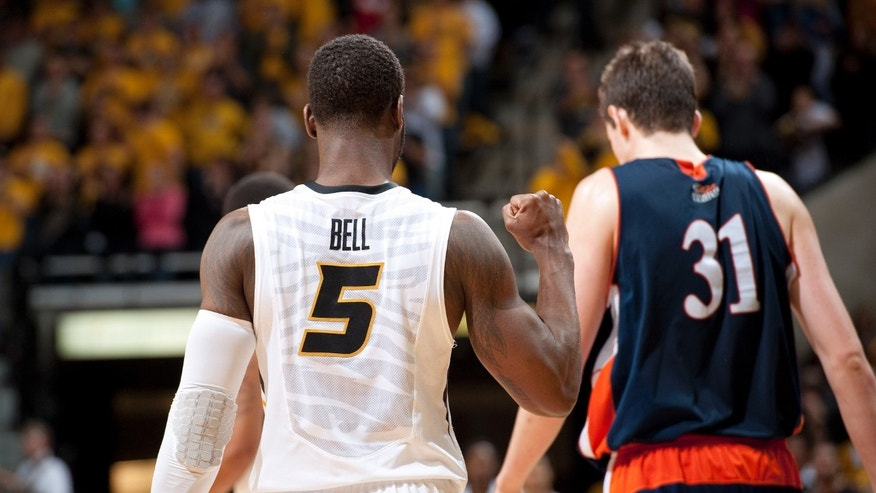 Missouri's Keion Bell, left, pumps his fist in front of Bucknell's Mike Muscala, right, at the end of Missouri's 66-64 victory in an NCAA college basketball game Saturday, Jan. 5, 2013, in Columbia, Mo. (AP Photo/L.G. Patterson)