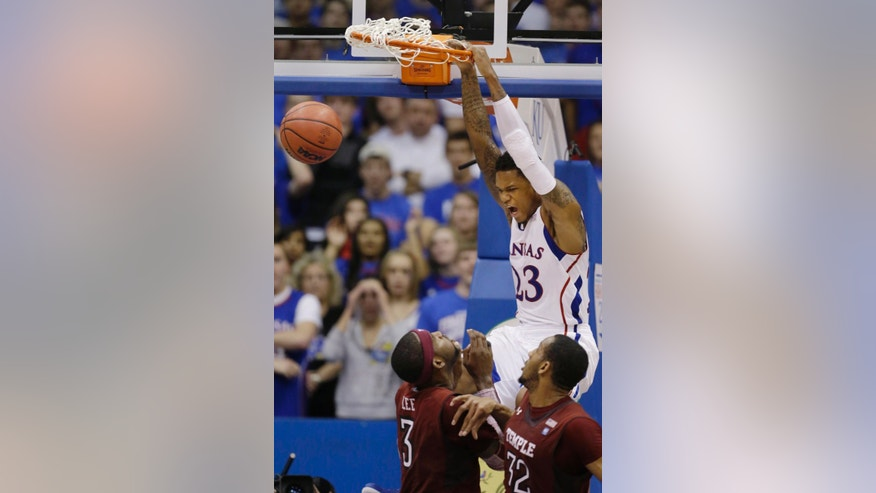 Kansas guard Ben McLemore (23) dunks over Temple forward Anthony Lee (3) during the second half of an NCAA college basketball game in Lawrence, Kan., Sunday, Jan. 6, 2013. Kansas defeated Temple 69-62. (AP Photo/Orlin Wagner)