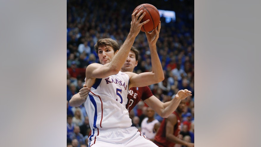 Kansas center Jeff Withey (5) works in front of Temple forward Jake O'Brien during the first half of an NCAA college basketball game in Lawrence, Kan., Sunday, Jan. 6, 2013. (AP Photo/Orlin Wagner)