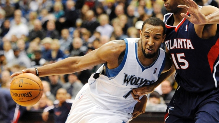 Minnesota Timberwolves' Derrick Williams (7) drives against Atlanta Hawks' Al Horford (15), of the Dominican Republic, during the second quarter of an NBA basketball game, Tuesday, Jan. 8, 2013, in Minneapolis. (AP Photo/Hannah Foslien)