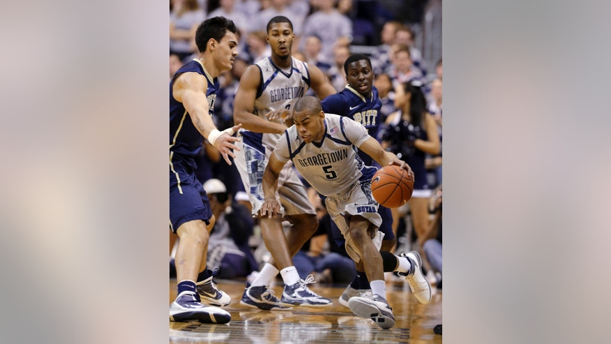 Georgetown guard Markel Starks (5) drives against Pittsburgh center Steven Adams (13) during the first half of an NCAA college basketball game, Tuesday, Jan. 8, 2013, in Washington. (AP Photo/Alex Brandon)