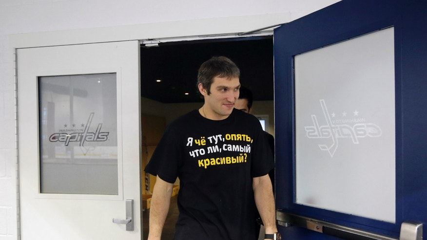 Washington Capitals player Alex Ovechkin, from Russia, walks out of the locker room before answering questions from the media at an NHL hockey availability at Kettler Capitals Iceplex, Tuesday, Jan. 8, 2013, in Arlington, Va. (AP Photo/Pablo Martinez Monsivais)