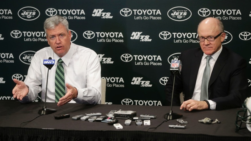 New York Jets NFL team head coach Rex Ryan, left, speaks while Jets owner Woody Johnson looks on during a news conference Tuesday, Jan. 8, 2013 in Florham Park, N.J.  (AP Photo/Seth Wenig)