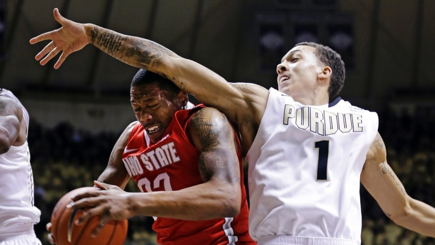 Ohio State guard Lenzelle Smith Jr., left, grabs a rebound under Purdue guard Anthony Johnson in the first half of an NCAA college basketball game in West Lafayette, Ind., Tuesday, Jan. 8, 2013. (AP Photo/Michael Conroy)