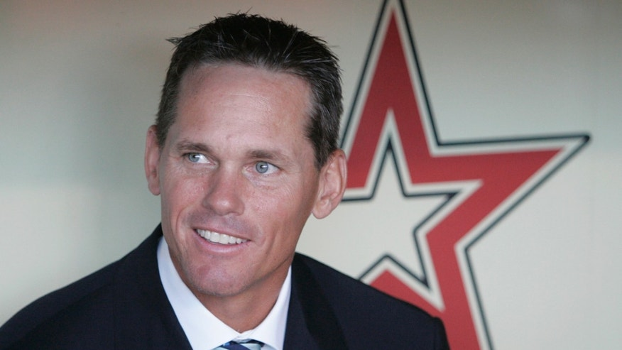 FILE - This is an Aug. 17, 2008 file photo shows former Houston Astros baseball player Craig Biggio sitting in the dugout during his introduction at his number retirement ceremony in Houston. Steroid-tainted stars Barry Bonds, Roger Clemens and Sammy Sosa have been denied entry to baseball's Hall of Fame with voters failing to elect any candidates for only the second time in four decades. Biggio, 20th on the career list with 3,060 hits, topped the 37 candidates with 68.2 percent of the 569 ballots, 39 shy of the 75 percent needed.  (AP Photo/Pat Sullivan, File)