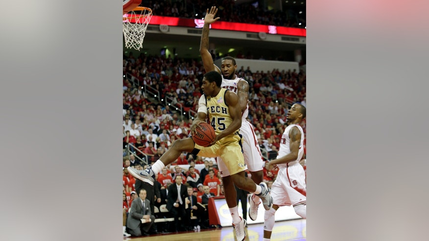 Georgia Tech's Solomon Poole (45) drives to the basket as North Carolina State's Richard Howell defends during the second half of an NCAA college basketball game in Raleigh, N.C., Wednesday, Jan. 9, 2013. North Carolina State won 83-70. (AP Photo/Gerry Broome)