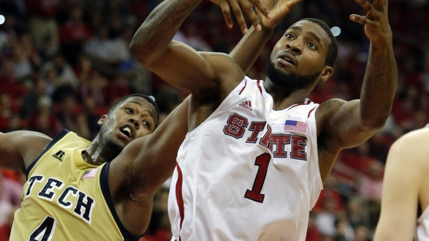 North Carolina State's Richard Howell (1) and Georgia Tech's Robert Carter (4) reach for the ball during the second half of an NCAA college basketball game in Raleigh, N.C., Wednesday, Jan. 9, 2013. North Carolina State won 83-70. (AP Photo/Gerry Broome)