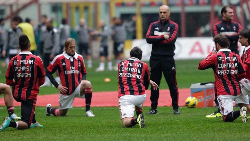 "From left, AC Milan's Kevin Prince Boateng, Massimo Ambrosini, Giampaolo Pazzini and Antonio Nocerino sport jerseys reading ""AC Milan against racism"" as they warm up prior to the start of the Serie A soccer match between AC Milan and Siena at the San Siro stadium in Milan, Italy, Sunday, Jan. 6, 2013. A friendly match between AC Milan and lower division club Pro Patria was abandoned last Thursday after racist chants directed at Milan's black players, the latest incident of racial abuse that continues to blight the sport. (AP Photo/Antonio Calanni)"