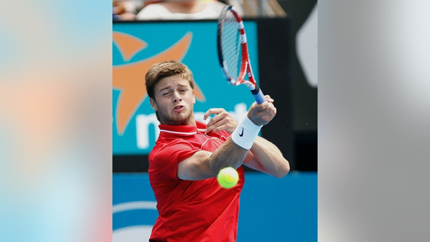 Ryan Harrison of the United State plays a forehand shot to fellow countryman John Isner at the Sydney International Tennis tournament in Sydney, Australia, Wednesday, Jan. 9, 2013.(AP Photo/Rob Griffith)