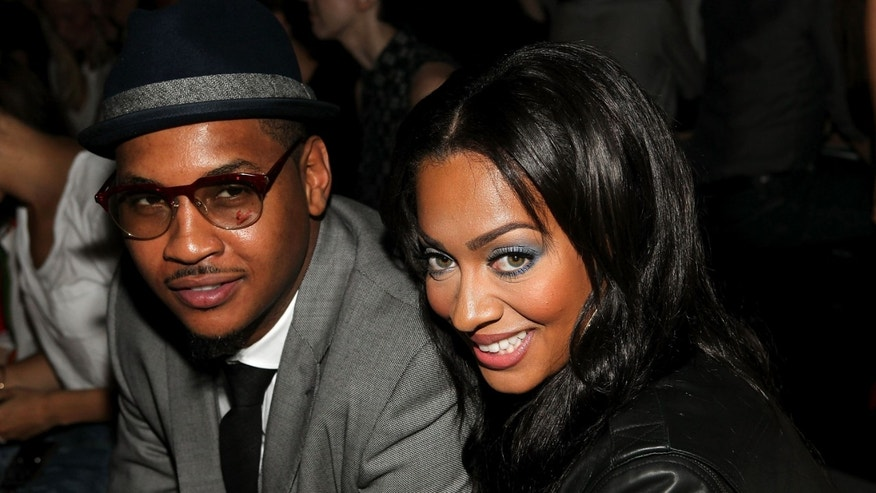 NEW YORK, NY - SEPTEMBER 09:  NBA player Carmelo Anthony (L) and LaLa Anthony attends the Rag & Bone Spring 2012 fashion show during Mercedes-Benz Fashion Week at 330 West Street on September 9, 2011 in New York City.  (Photo by Paul Morigi/Getty Images)