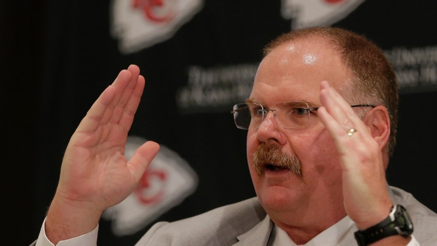New Kansas City Chiefs NFL team head football coach Andy Reid talks to the media during a news conference at Arrowhead Stadium Monday, Jan. 7, 2013, in Kansas City, Mo. (AP Photo/Charlie Riedel)