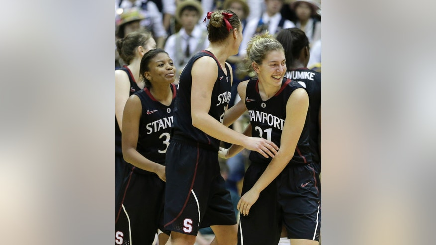Stanford's Toni Kokenis, right, celebrates with teammate Joslyn Tinkle, center, and Amber Orrange in the second half of an NCAA college basketball game against California Tuesday, Jan. 8, 2013, in Berkeley, Calif. (AP Photo/Ben Margot)